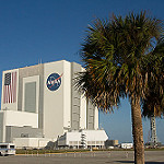 CRS-3 Scrub 1 Bill: VAB with palm trees