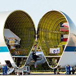 Super Guppy brings EM-1 capsule to KSC (Jared Haworth): Orion's protective enclosure is visible on the left in this view of the Super Guppy