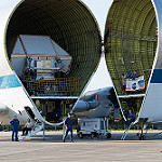Super Guppy brings EM-1 capsule to KSC (Jared Haworth): Preparing to unload Orion capsule
