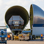 Super Guppy brings EM-1 capsule to KSC (Jared Haworth): Transport Lift in position to remove Orion from the Super Guppy