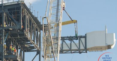 Workers from Hensel Phelps guide the Crew Access Arm in to place at the 12th level of the Boeing Crew Access Tower.