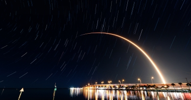 SpaceX's latest Starlink launch streaks to orbit, visible over Titusville's Max Brewer Bridge.  Photo credit: Michael Seeley / We Report Space.