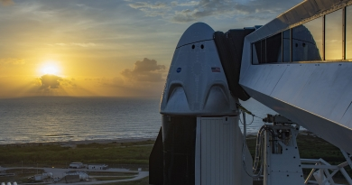 The sun rises over Kennedy Space Center's Launch Complex 39A and SpaceX's Crew Dragon capsule.  Official SpaceX Photo.