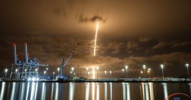 SpaceX's latest batch of Starlink satellites is launched from Cape Canaveral Air Force Station, while recovery crews work on the recently returned first stage booster from last weekend's Demo-2 Crew Dragon mission.  Photo credit: Michael Seeley / We Report Space